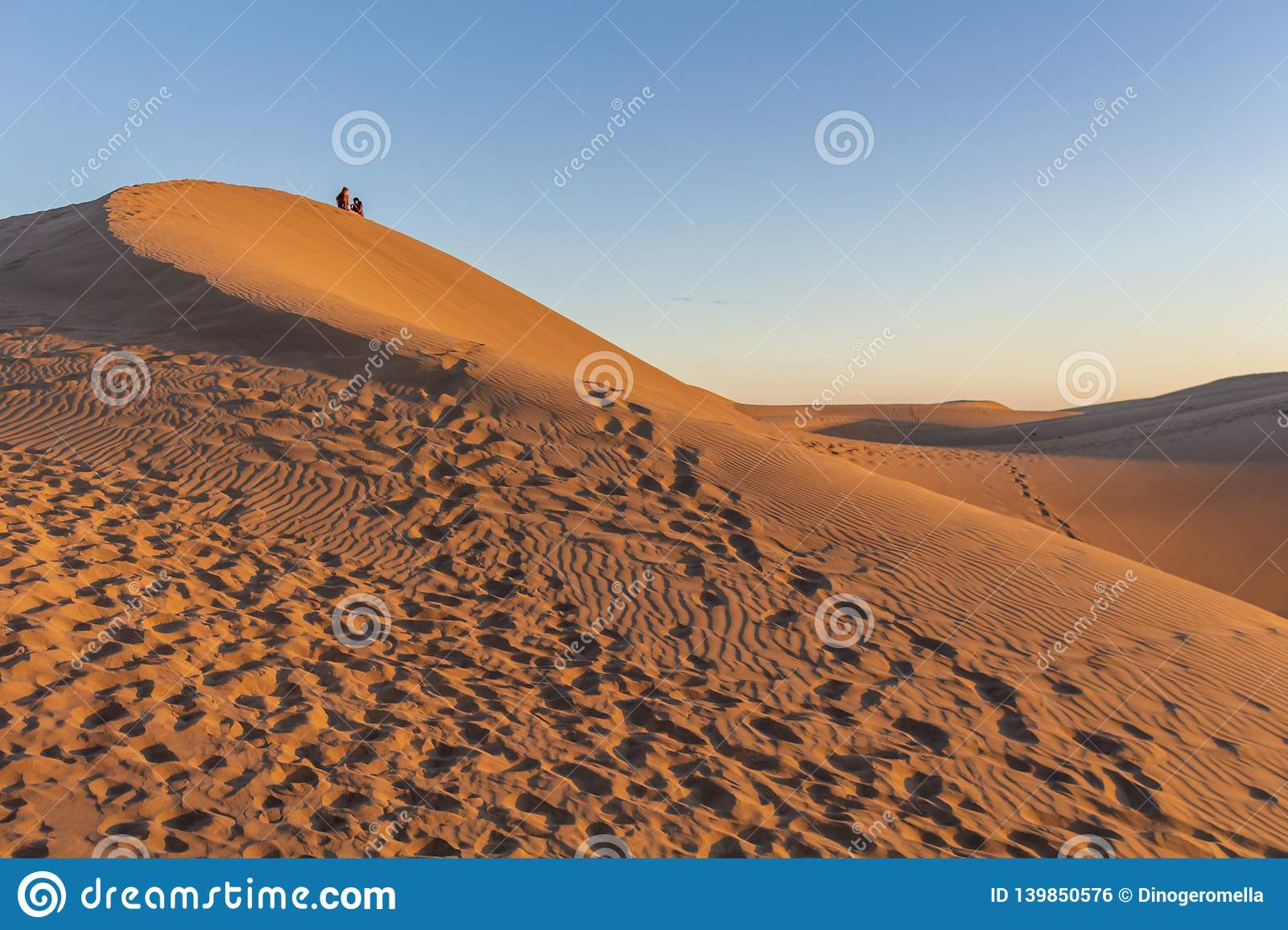 Sitting on the desert dunes in Gran Canaria at sunset