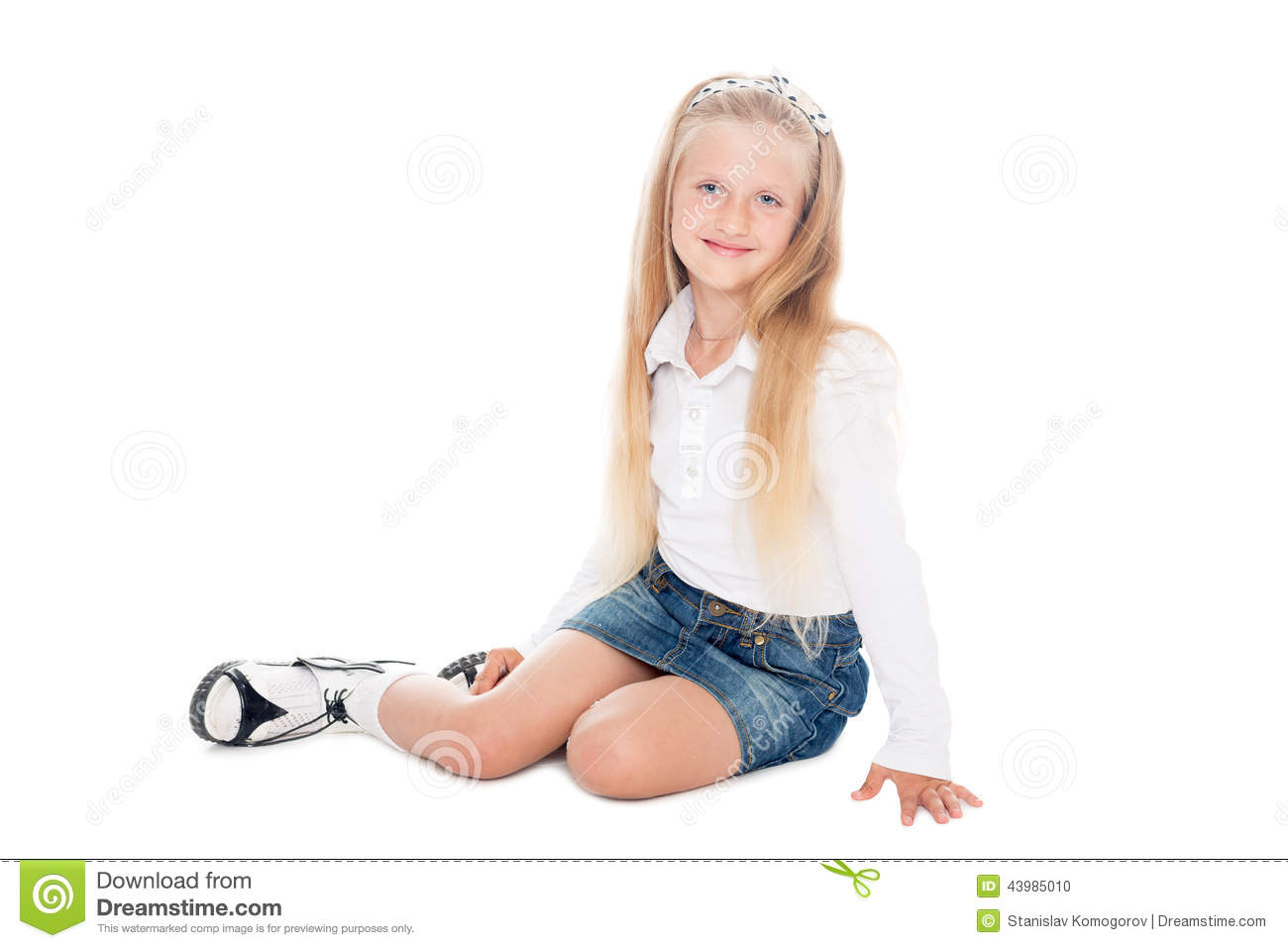 Awesome  Haired Cheerful Girl In A Short Skirt Sitting On A Chair And Gesturing