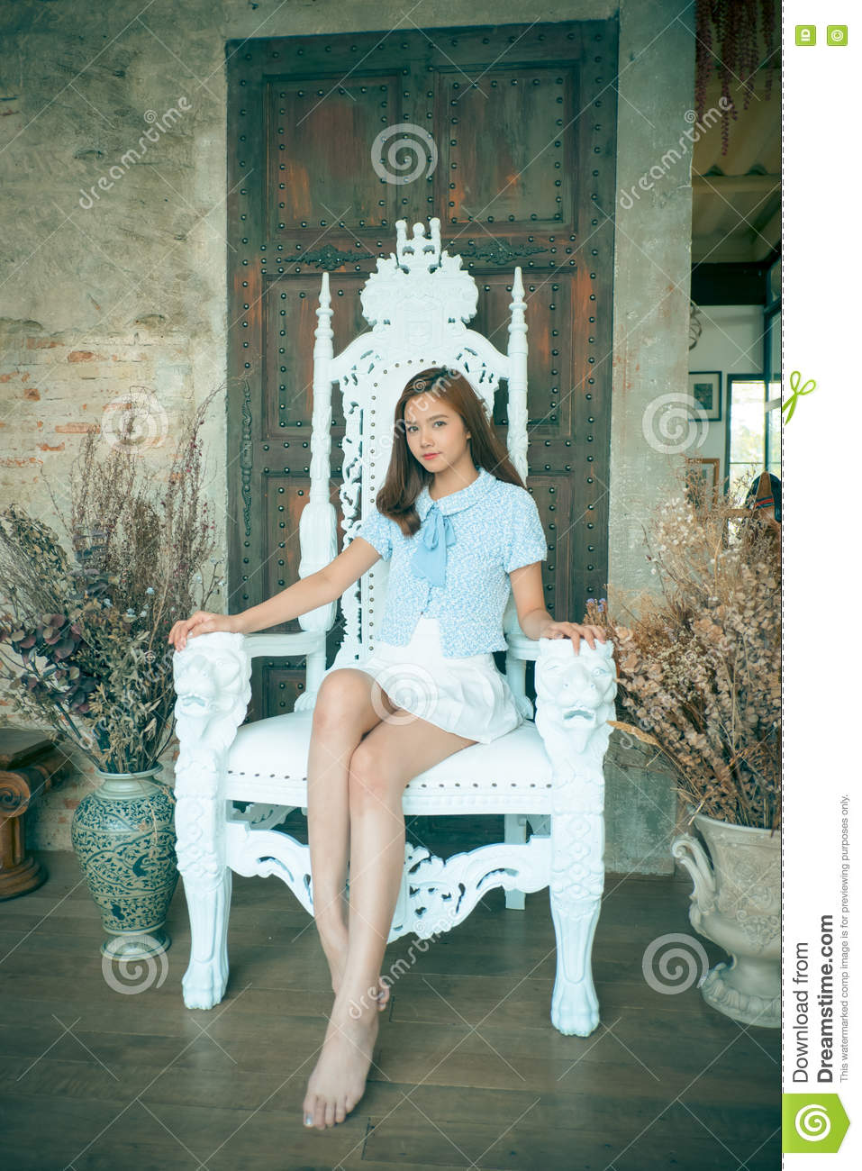 Sitting Pretty Girl Working On A Majestic Throne Stock
