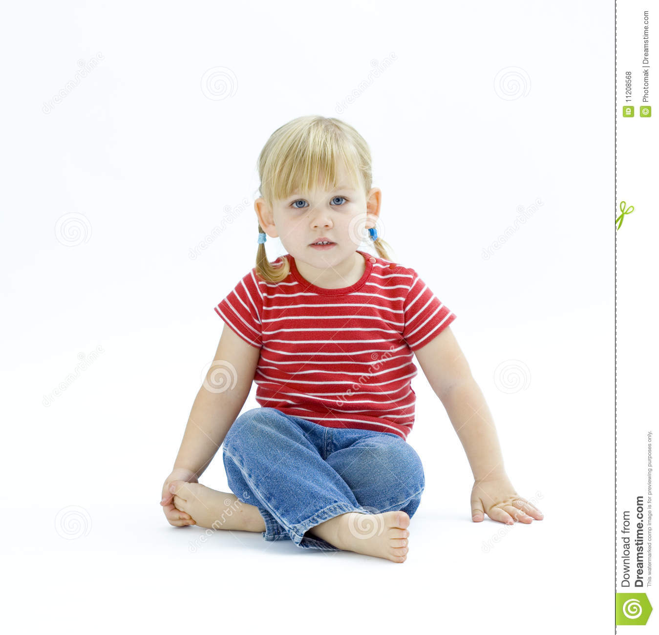 Sitting squat on the floor little girl royalty free stock photos