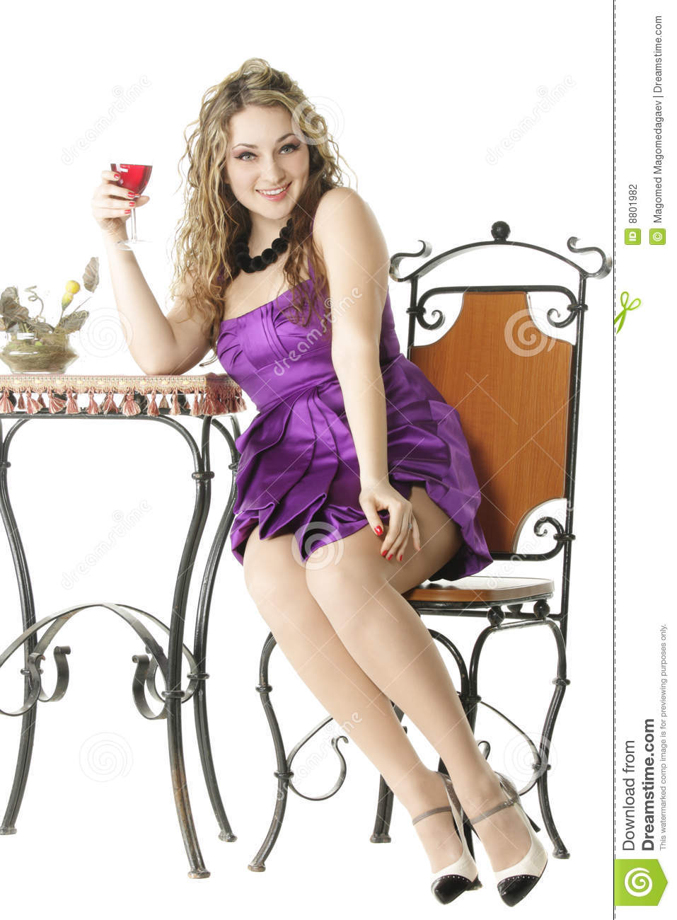 Sitting at table with glass of wine