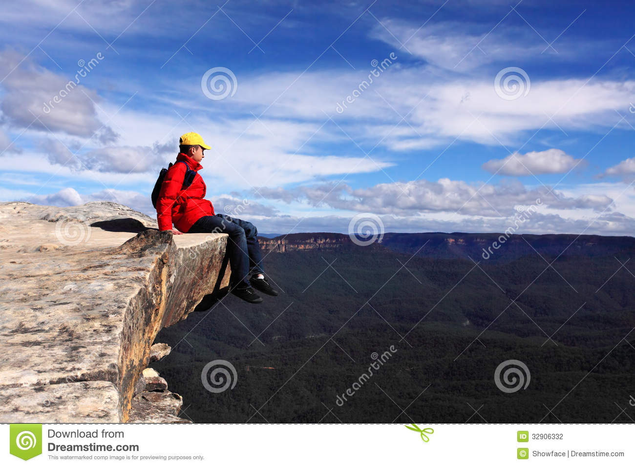 Hiker on mountain ledge - risk freedom adventure s