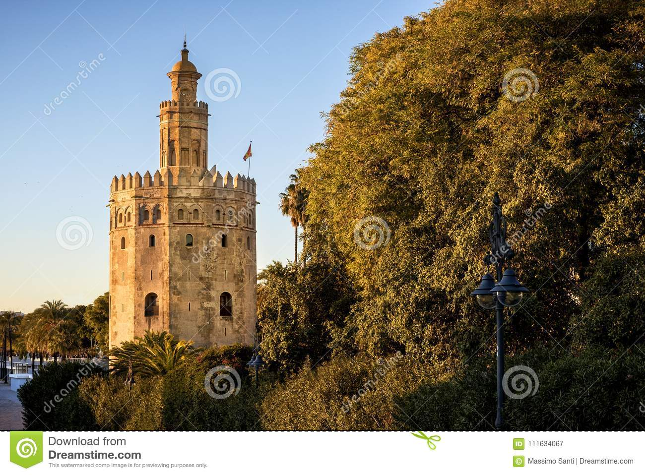 Siville - View of Golden Tower Torre del Oro of Seville, Andalusia, Spain over river Guadalquivir at sunset