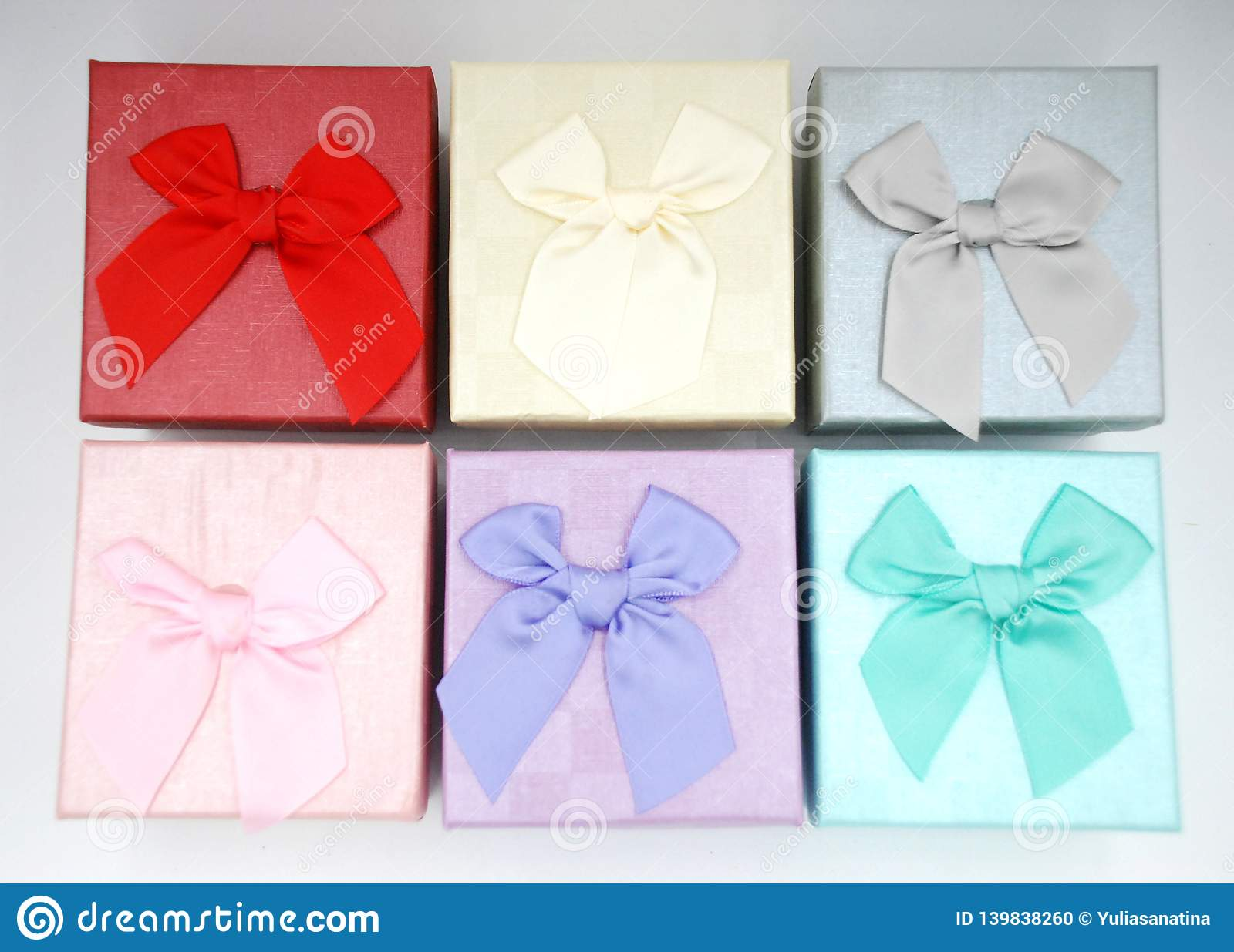Six gift boxes with the bow tie on the top