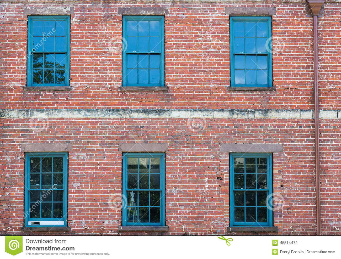 Six green windows on old brick building stock photo Brick and wood house