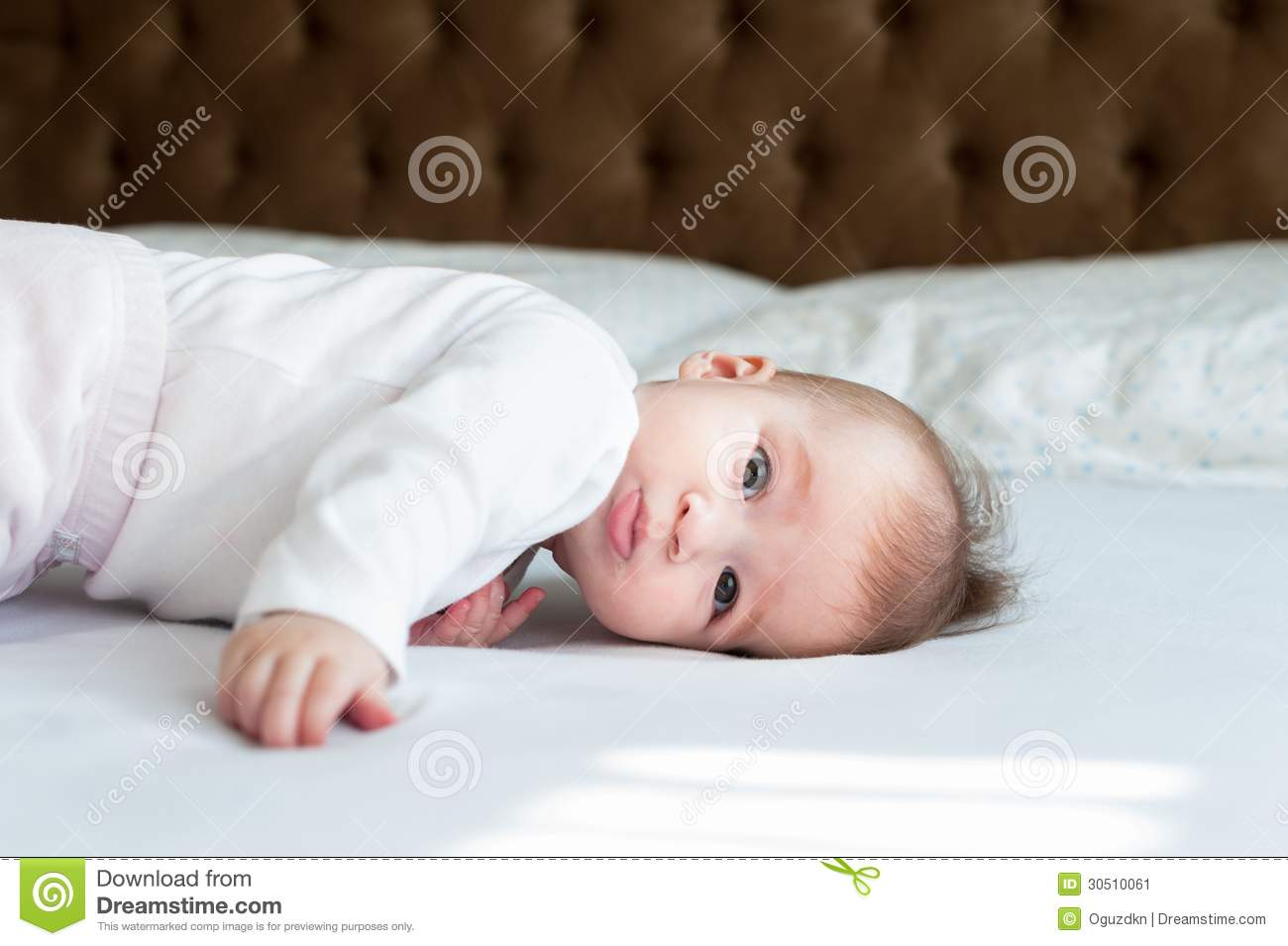 six month baby girl laying on the bed stock image image