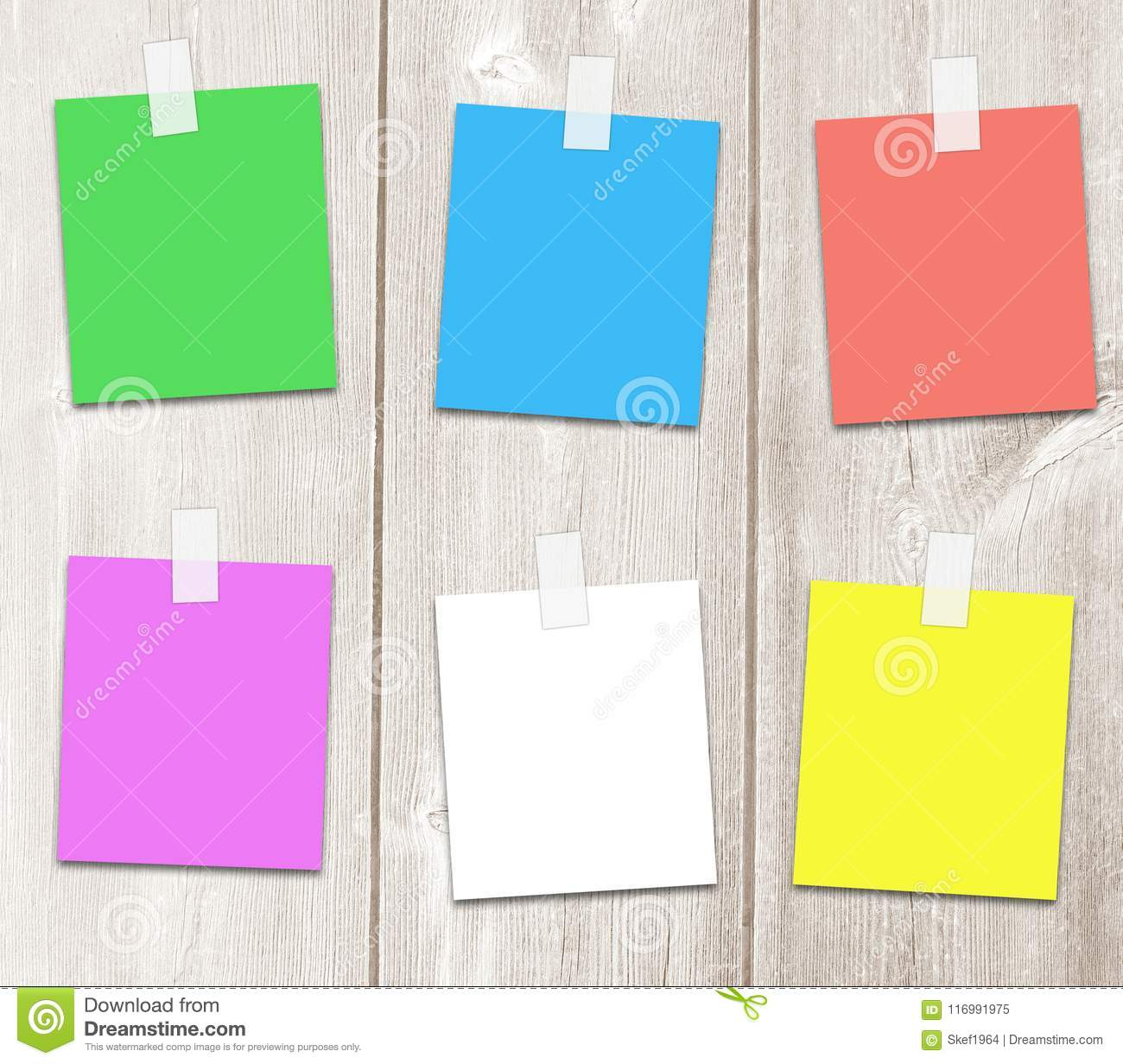 six multi colored paper notes on wooden surface stock illustration