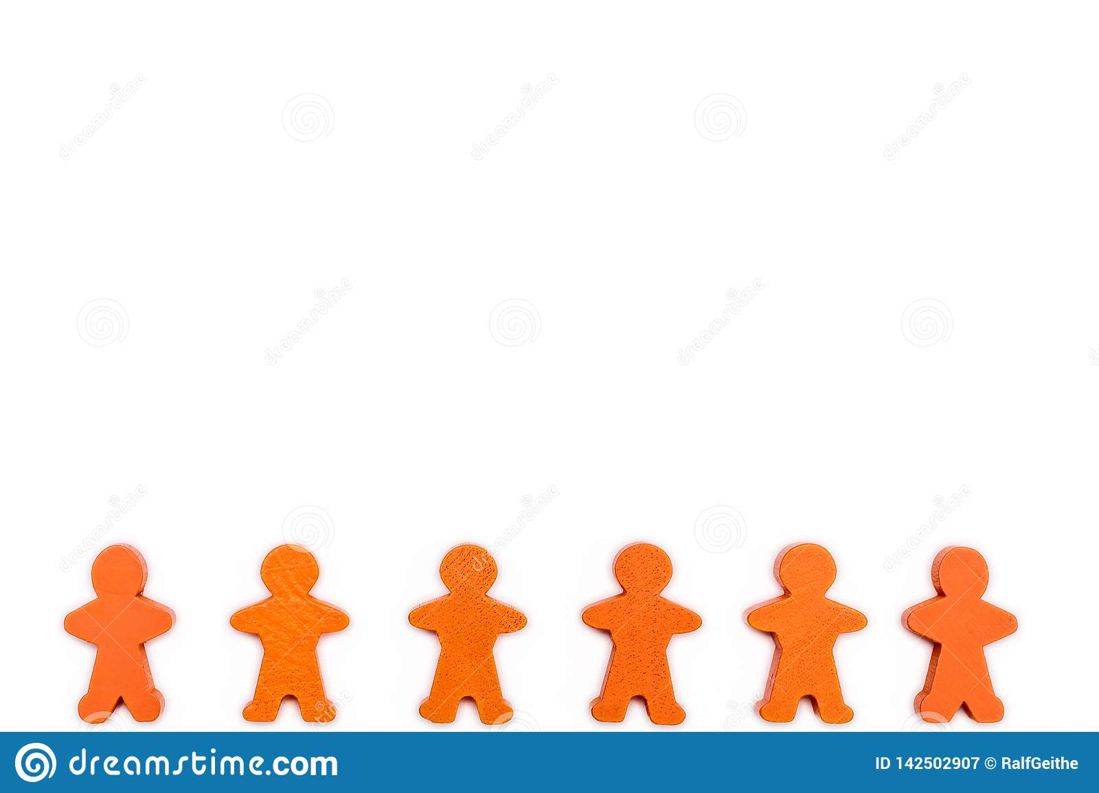 White background with human chain of wooden figures as a symbol of a community