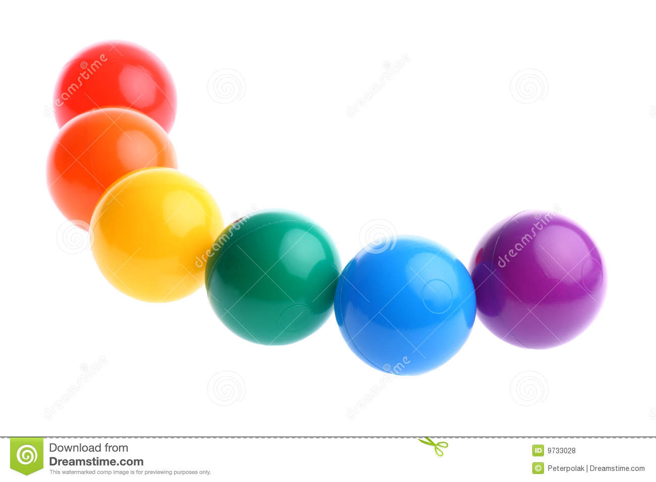 Plastic Toy Balls : Six shiny coloured plastic toy balls in row stock photo