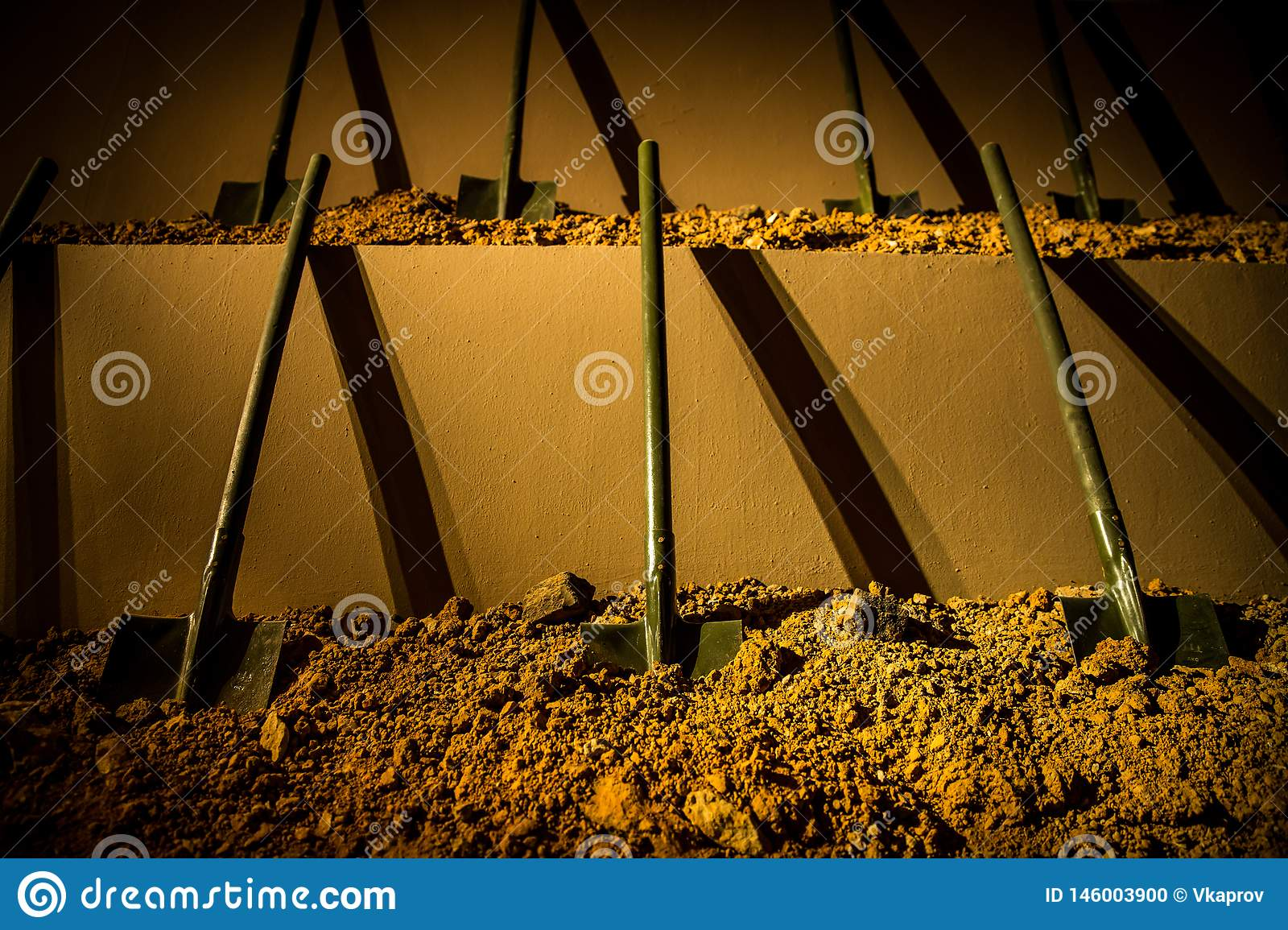 Six symmetrically placed shovels stuck into the ground