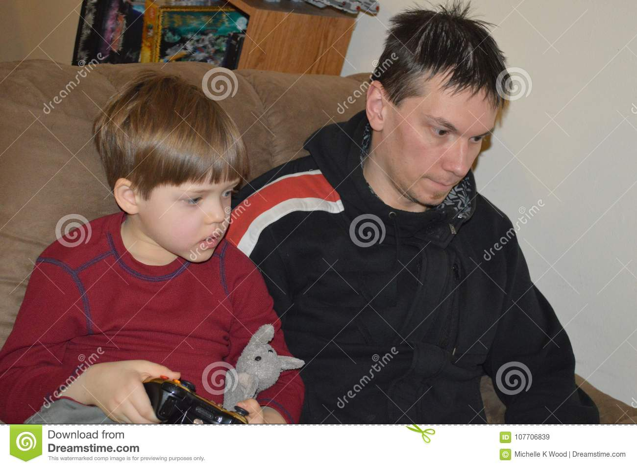 Single father and son play video game