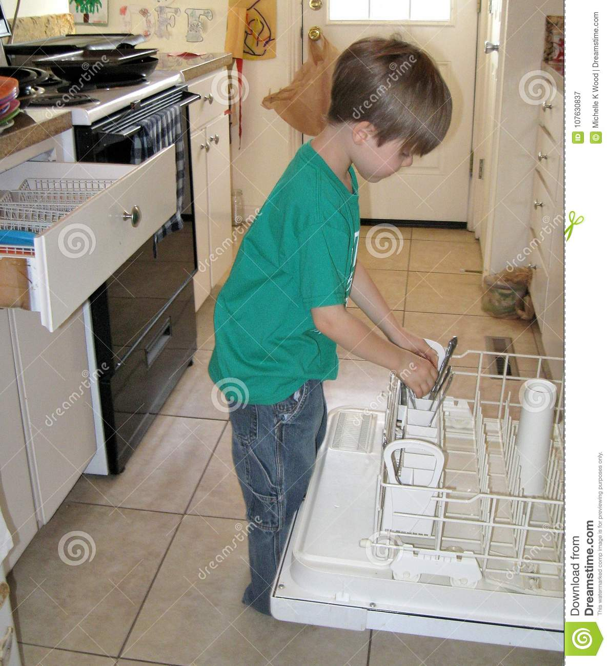 Boy taking silverware out of dishwasher