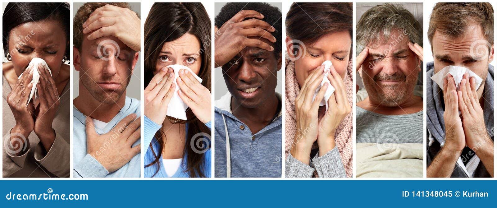 Sjukt folk som har influensa, förkylning och att nysa