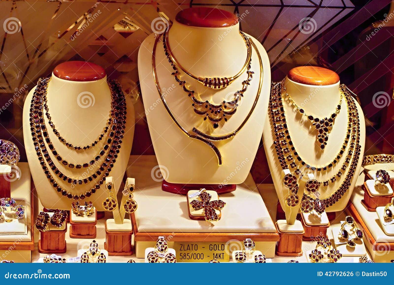 Skärm för lagerfönster av guld och Garnet Jewelry