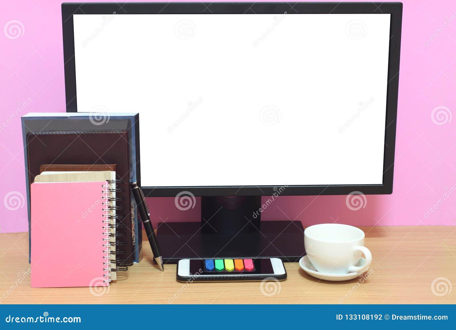 Skärmen och böcker för bärbar dator förläggas har den tomma på skrivbordet och Co