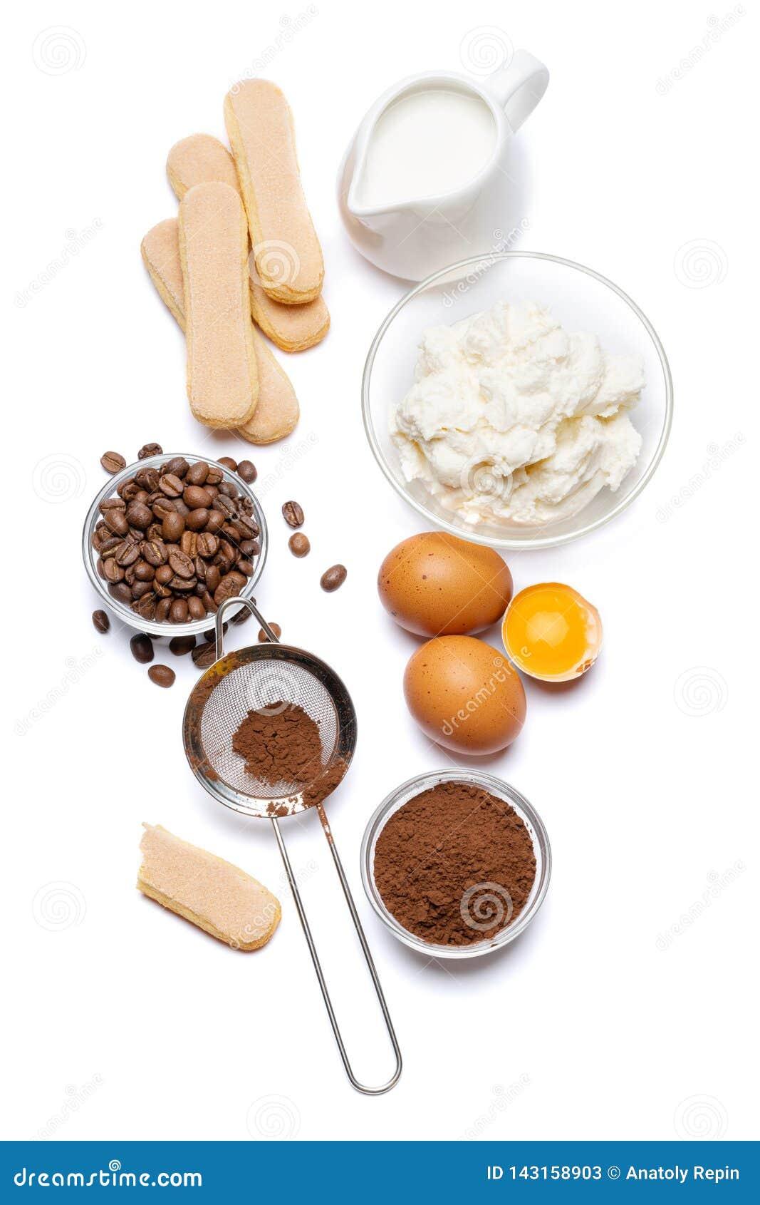 Składniki dla kulinarnego tiramisu Savoiardi biskwitowi ciastka, mascarpone, śmietanka, cukier, kakao, kawa i jajko -,