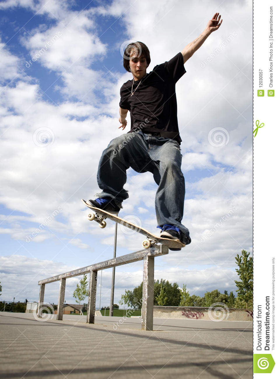 skateboarder doing a crooked grind stock image