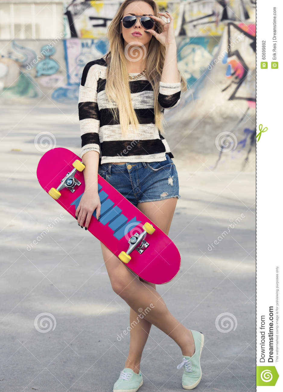 1b0172c36df Beautiful and street girl posing with her skateboard