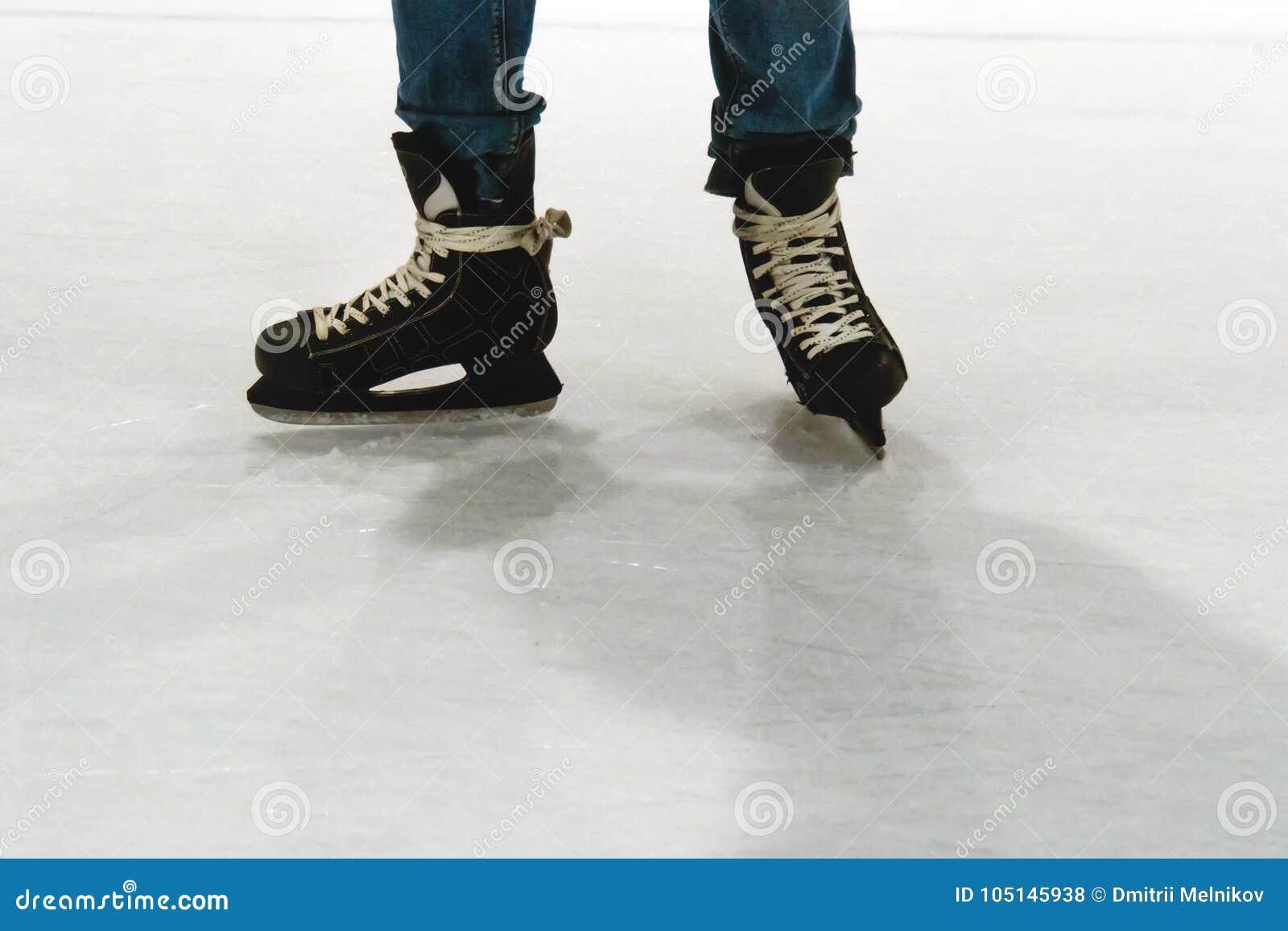 Skater legs at skating rink