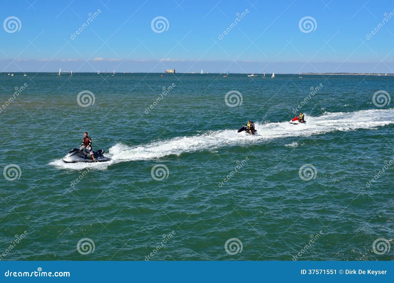 Ski jets returning to harbor in Boyardville on ile d oleron, France