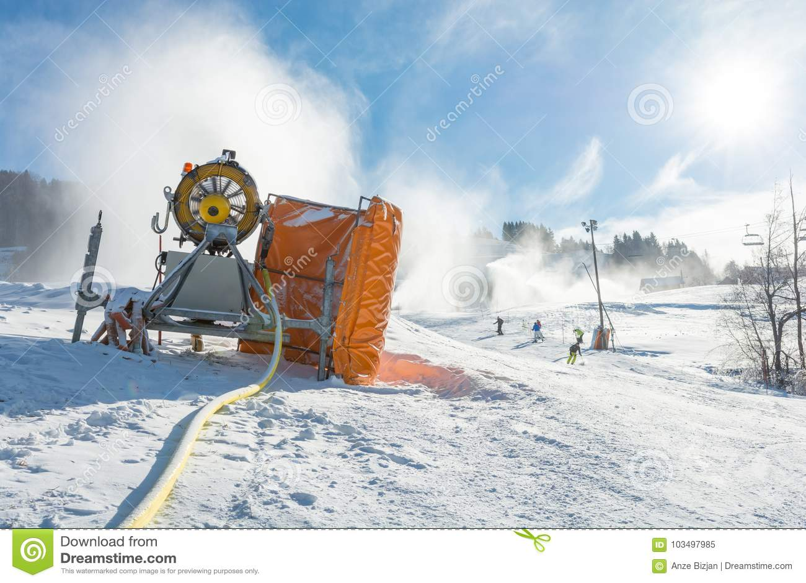 ski resort with snow gun making new surface. stock image - image of