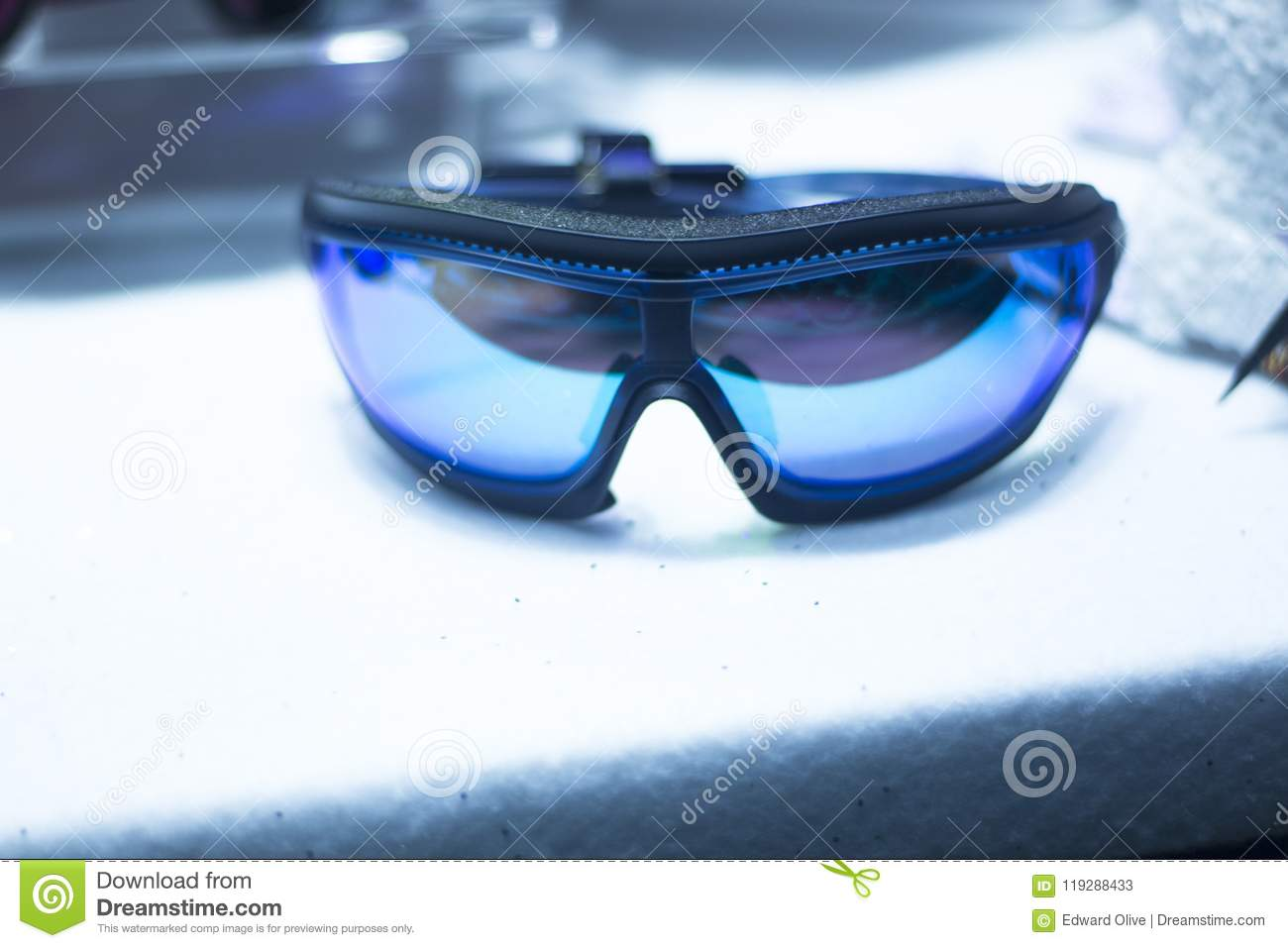 8ad6af9ed8 Modern high technology anti reflection ski and snowboard shop goggles on  sale in store window display.