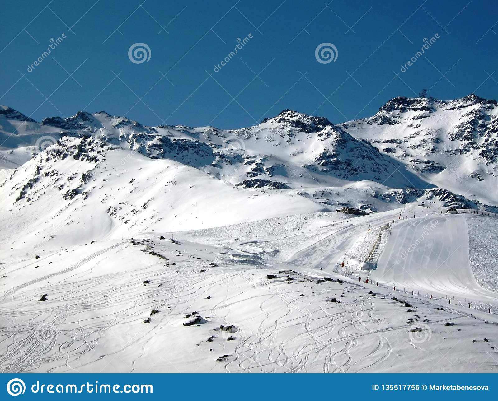 Ski traces and ski slope in the mountains