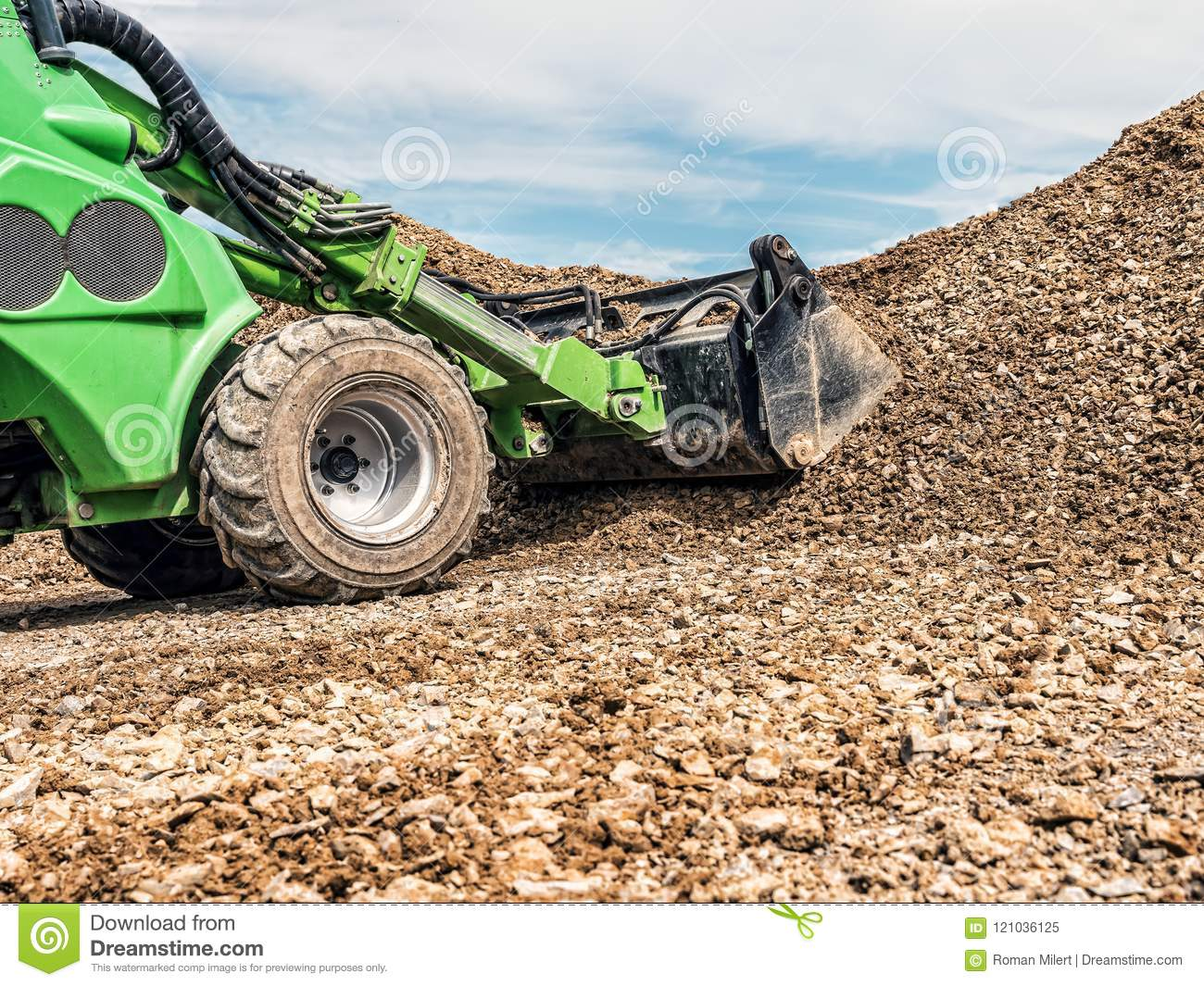 Skid loader at work stock image  Image of industry
