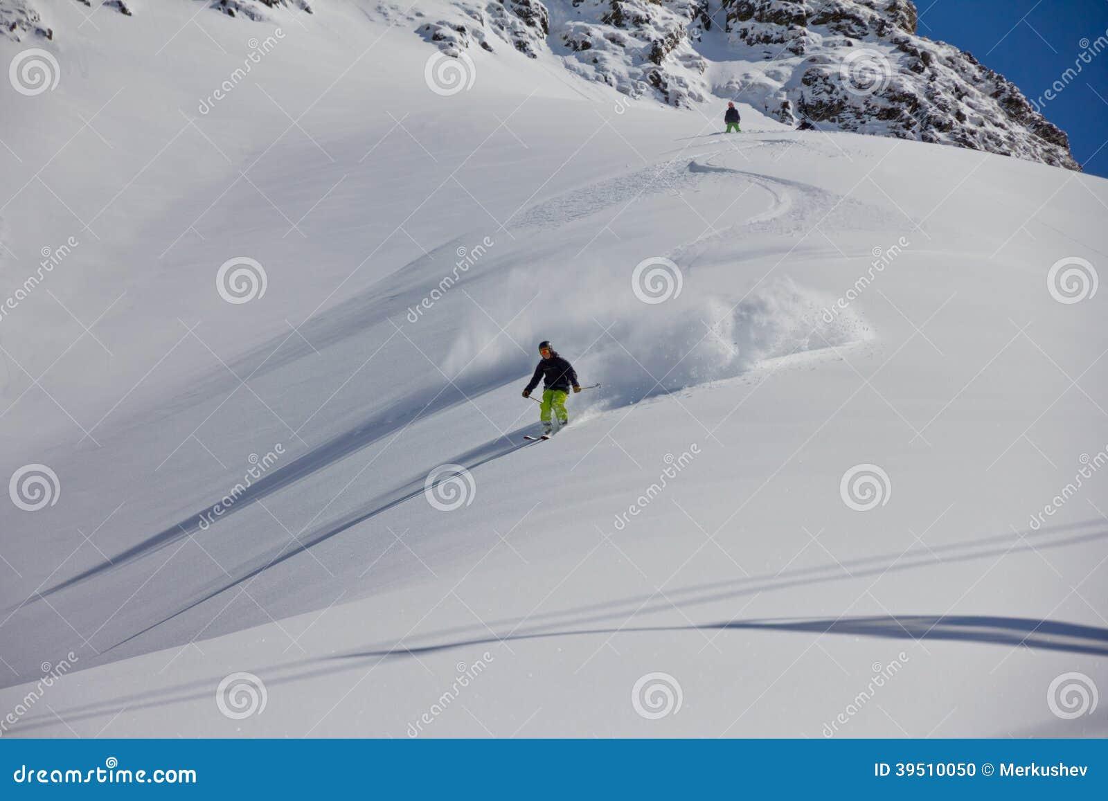 Skier in deep powder, extreme