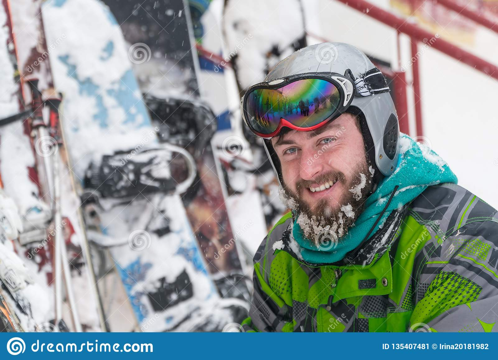 Skier in the mask on the face of a snow man and snow skis