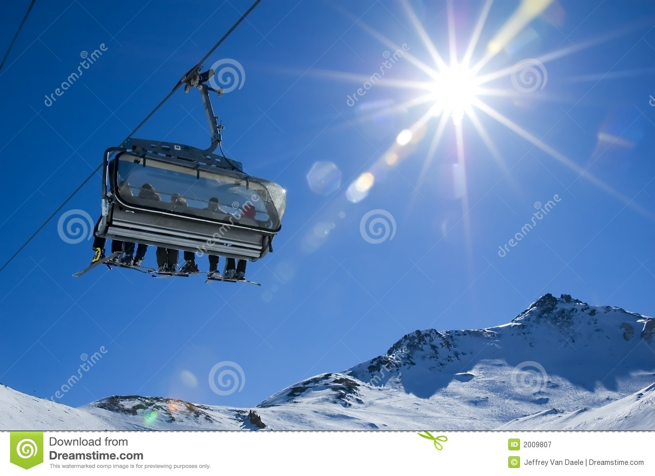 Skiers in a chairlift