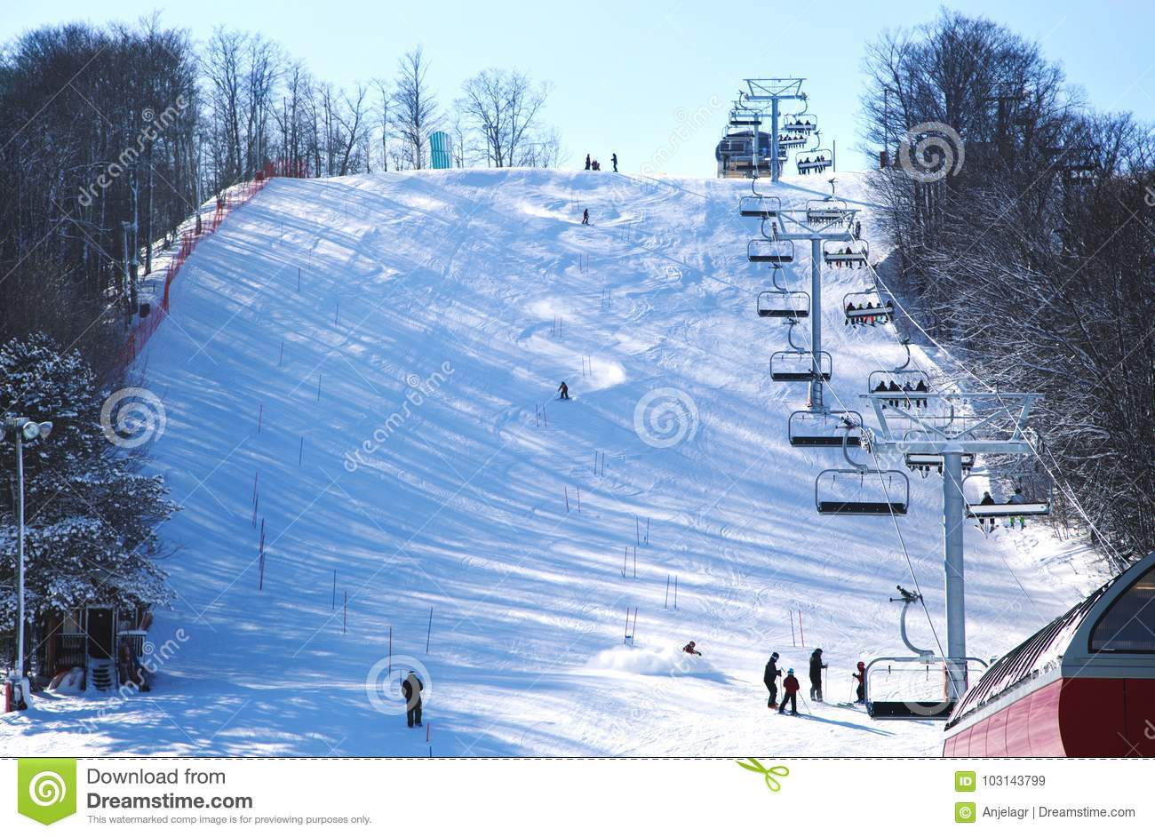 skiers going down the slope at horseshoe ski resort in barrie, canda