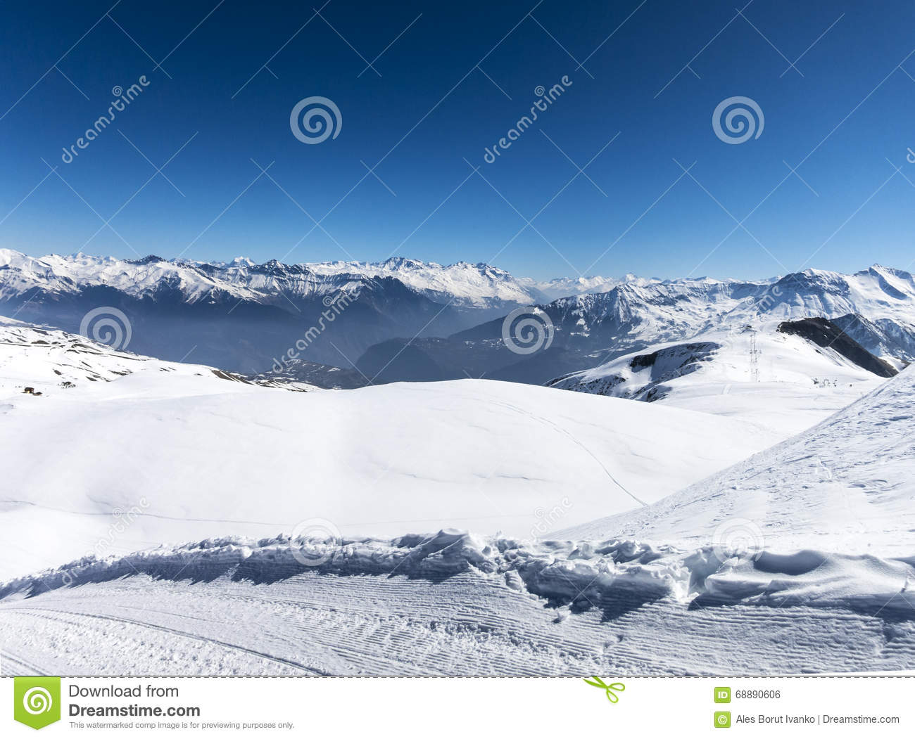 Skiing in French alps with a lot of sun