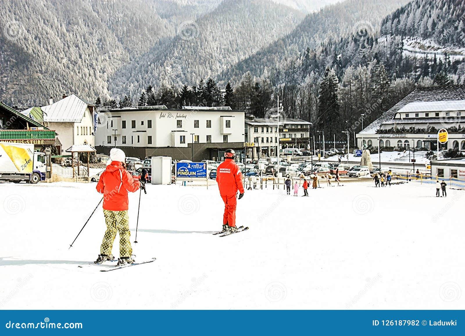 Alpine ski school. Instructor and student in colorful ski equipment