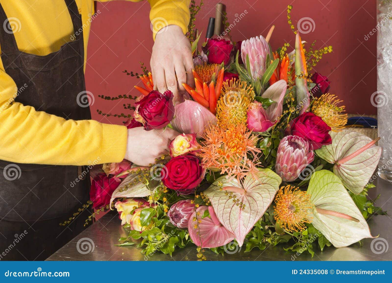 Skillful florist arranging rich flower bouquet