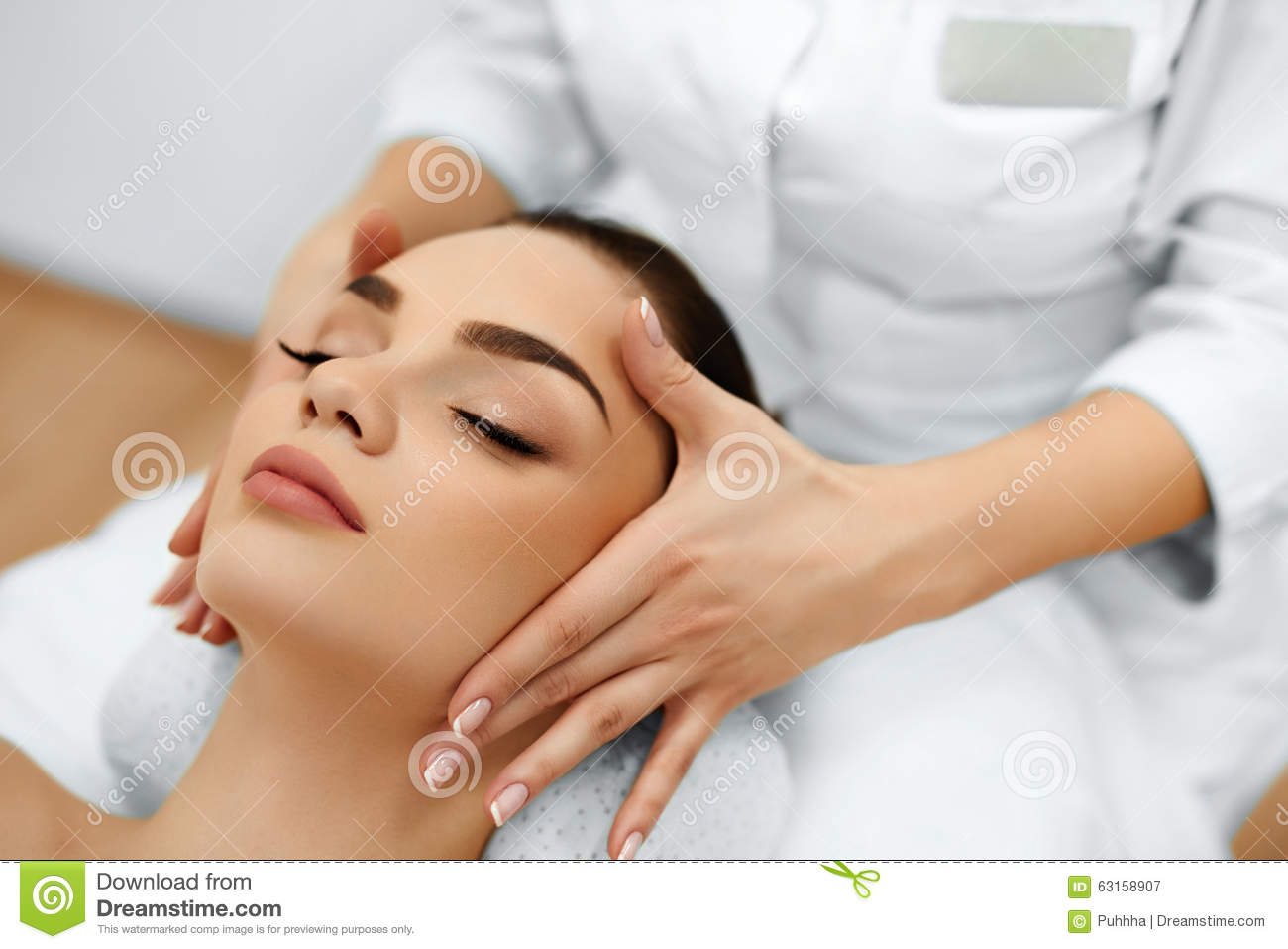 Skin body care woman getting beauty spa face massage for A beautiful you salon