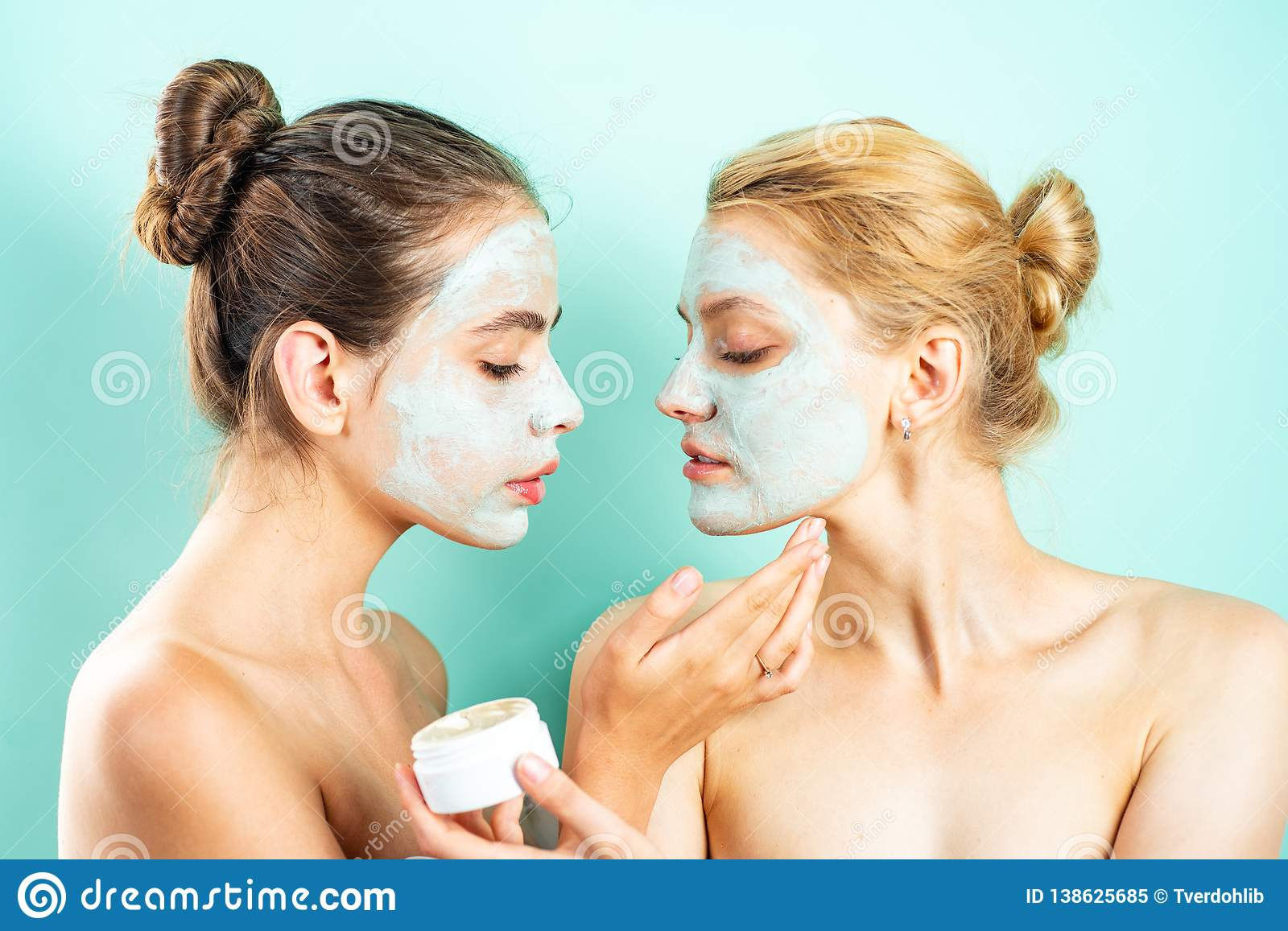 Skin care concept. Face cream. Portrait Of two Beautiful Young Female Models With Natural Facial Makeup.