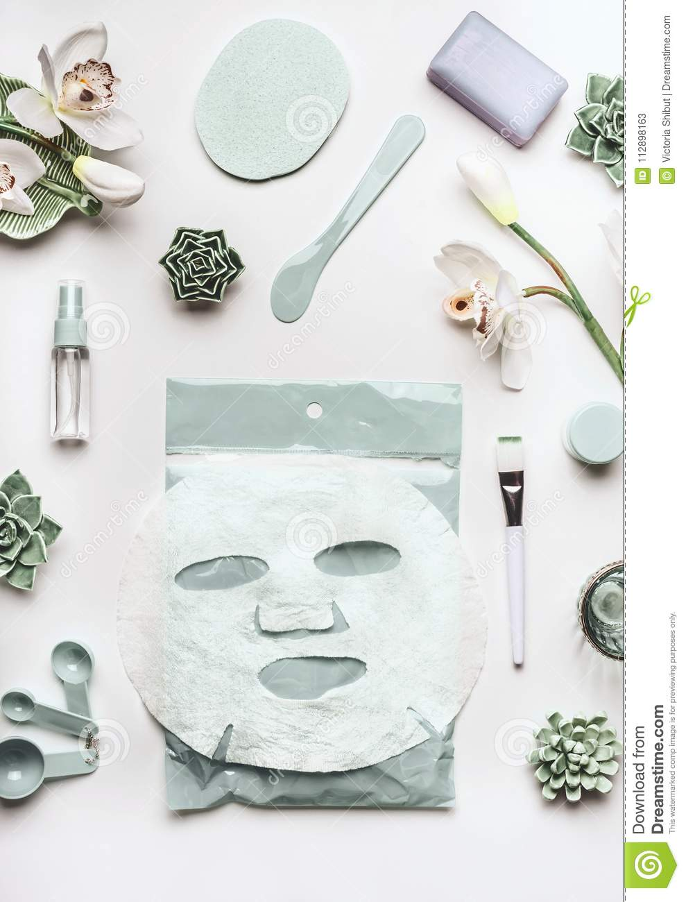 Skin Care Cosmetic Setting With Facial Sheet Mask Cleansing Products Succulents And Orchid Flowers On White Desktop Stock Image Image Of Measuring Herbal 112898163