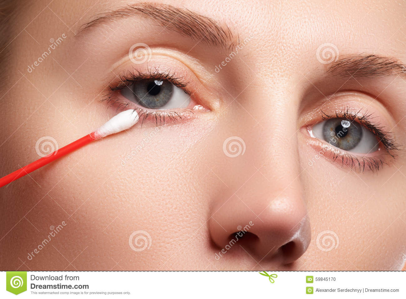 Skin care woman removing face makeup with cotton swab. Skin care concept. Caucasian model with perfect skin. Beauty & Spa.