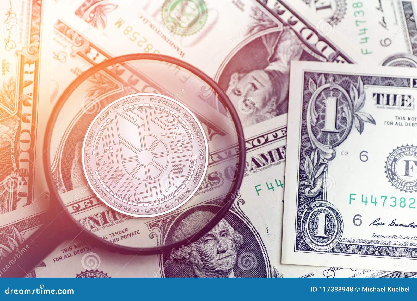 Skinande guld- BITSHARES-cryptocurrencymynt på oskarp bakgrund med illustrationen för dollarpengar 3d