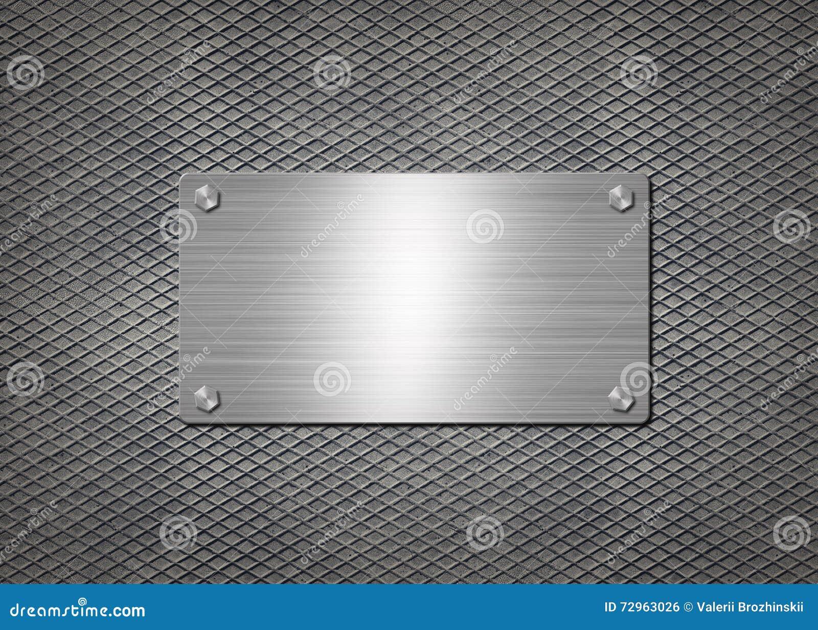 Skinande metallplatta på grå bakgrund