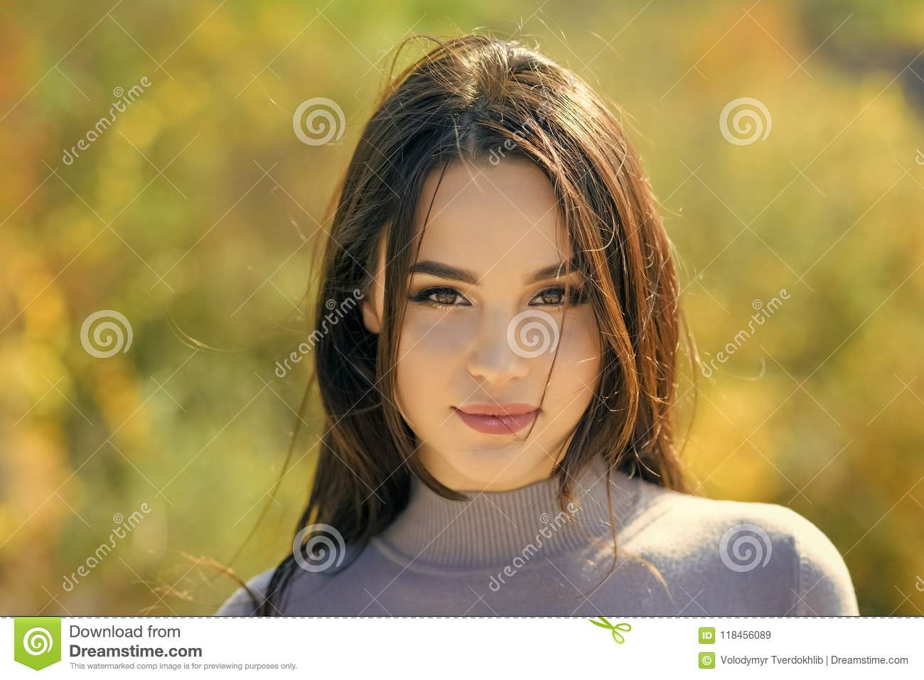 Skincare, youth, health. Energy, joy, serenity. Woman with long brunette hair. Girl with makeup face smiling on sunny