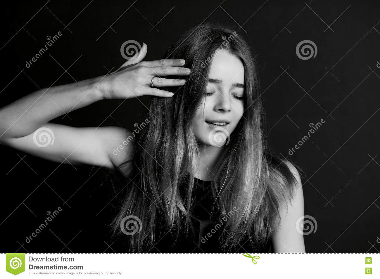 Skinny Tall Girl Of Model Appearance, Touching Hair. Stock Photo ...