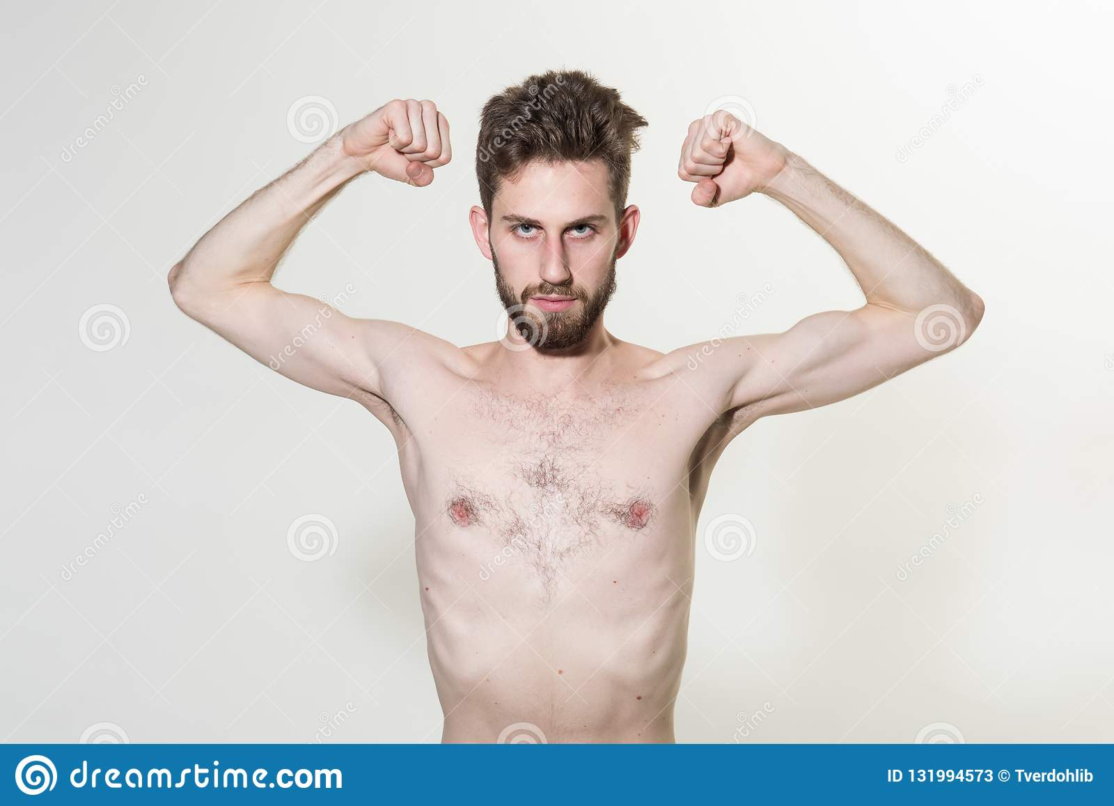 Skinny Young Man Flex Arms  Slim Man Do Sport Training  Stimulating