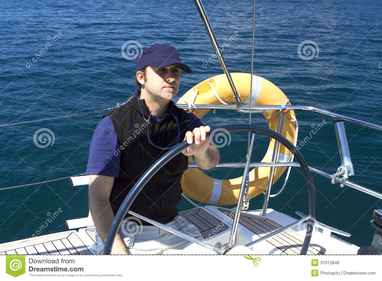 Download Skipper At The Wheel Of A Sailing Boat Stock Photo - Image of blue, nature: 31012848