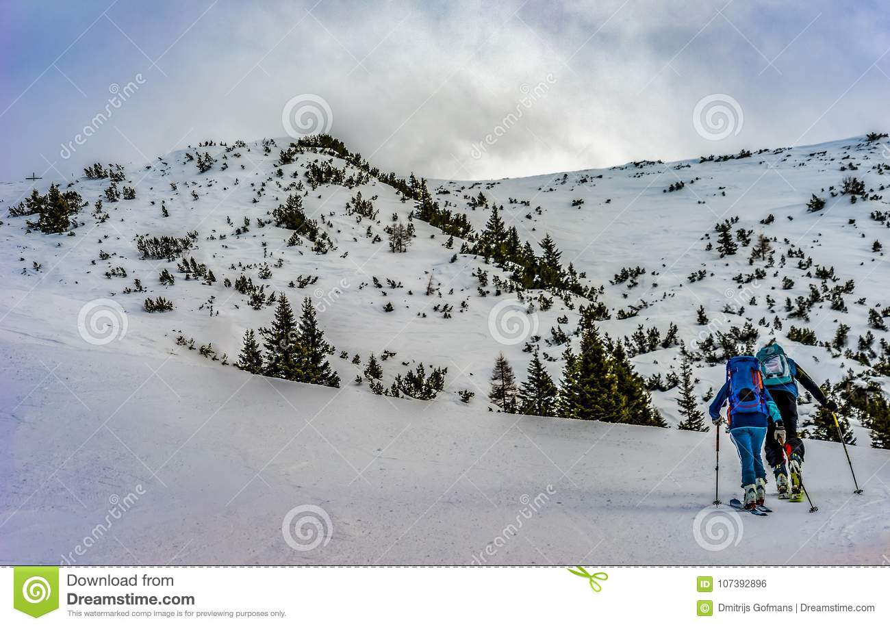 Skitouring on the mountain in Alps