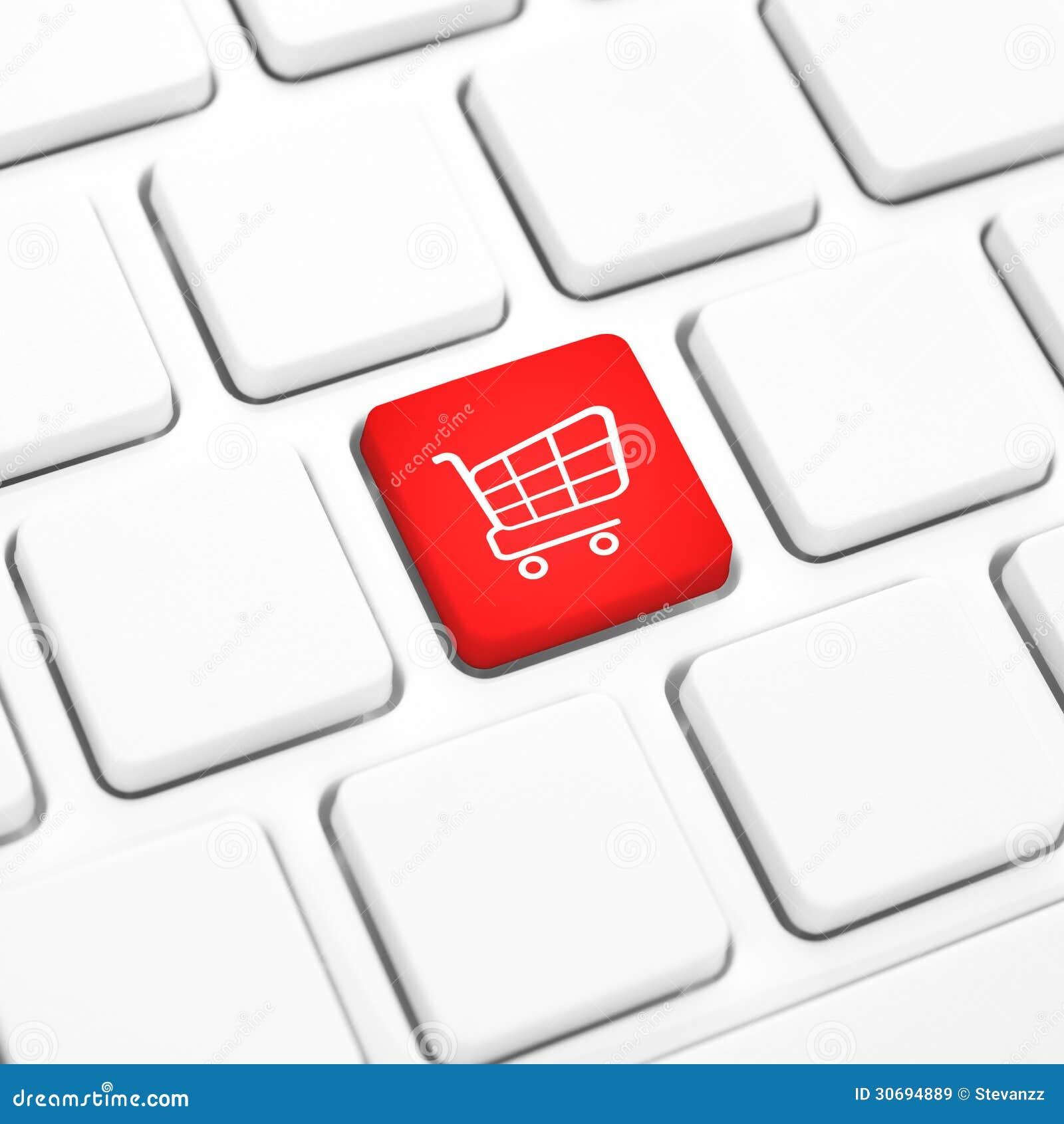Sklepowy online biznesowy pojęcie. Czerwony wózek na zakupy guzik, klucz na klawiaturze lub