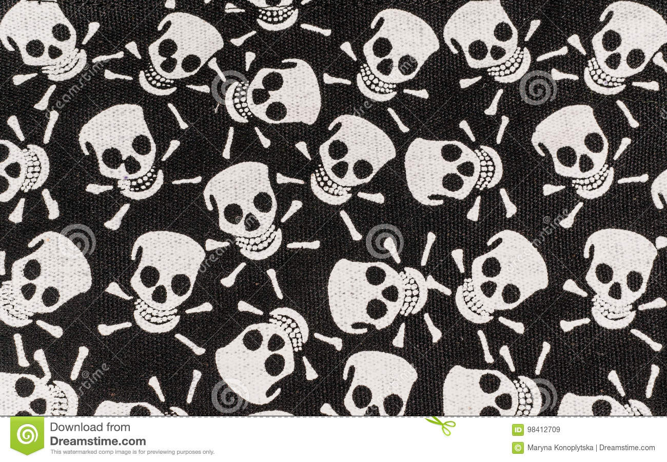 78d1ce3da5 Color print on cotton fabric. White skulls and bones on a black background