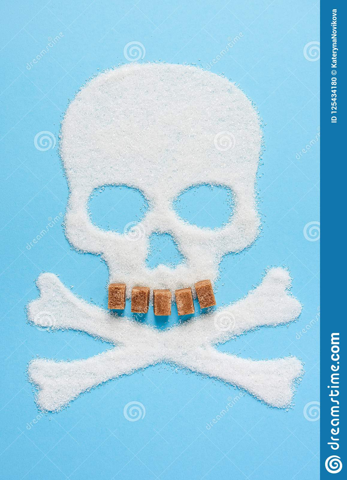 The skull made of sugar on blue blue background. Diabetes concept. Sugar Kills. Suggesting dieting concept. Copy space