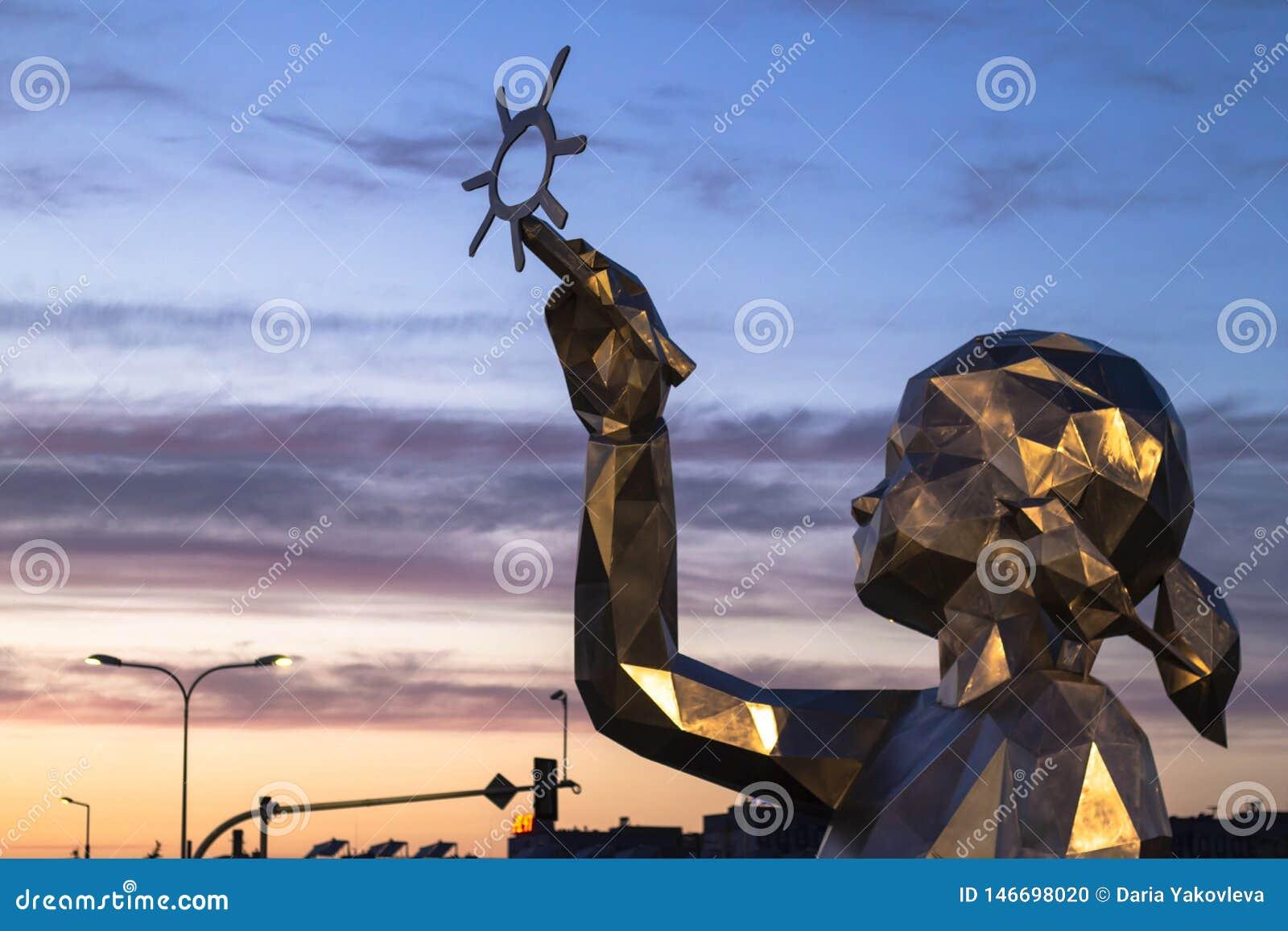 Skulptur av en flicka som drar solen